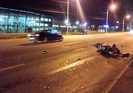 Accident pe Calea Borşului: Motociclist de 23 de ani grav rănit, după ce un şofer a virat pe linia dublă continuă şi nu i-a dat prioritate