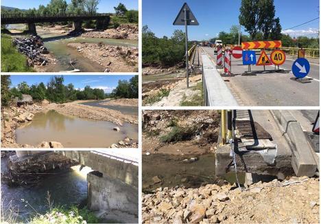 """SURPAT. Excavatoarele firmei Ile Construct SRL au """"invadat"""" Crişul Pietros în zona podului de lângă Drăgăneşti până când firma a ajuns subiectul unei anchete penale, care nu s-a terminat, însă, nici după un cincinal. Între timp, din cauza exploatărilor de materiale de nisip și pietriș, precum şi a viiturii de luna trecută, podul rutier a fost parţial închis, iar şoferii pot circula pe un singur fir şi cu o viteză limitată la 30 km/h  (foto: Horia Dumitraș)"""
