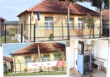 """PROPAGANDA DE PARTID. La fel ca toate grădiniţele reabilitate, şi cea din Ogeşti (foto) a fost dotată cu cazan şi boiler, care zac acum, inutile, în camera tehnică. Zilele trecute, clădirea a fost """"decorată"""" cu un banner uriaş al Vioricăi Dăncilă, şefa de partid a primăriţei Mariana Laza. A fost dat jos abia după ce BIHOREANUL a semnalat că nu e normal ca gardul grădiniţei să fie folosit în scopuri electorale"""