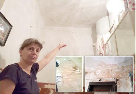 """VIAŢA CA UN CHIN. """"Săptămânal eu trebuie să frec pereţii şi tavanul cu soluţii antimucegai. Totuşi, când a venit în casa mea, constructorul a zis că el nu vede nicio problemă"""", susţine Ileana Borbely (foto), privind cu amărăciune spre tavanul înnegrit din baia locuinţei sale. Deşi urmele infiltraţiilor sunt evidente şi pe casa scării, bărbatul care a reparat acoperişul pretinde că n-a greşit cu nimic"""