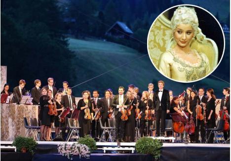 """MUZICĂ DE LA VIENA. În iunie, orădenii vor putea asculta Orchestra de Tineret din Viena (fundal), o obişnuită a festivalurilor internaţionale, care va interpreta """"Requiemul"""" lui Mozart, una din soliste urmând să fie Ileana Tonca (foto), soprană la Opera de Stat din capitala Austriei"""