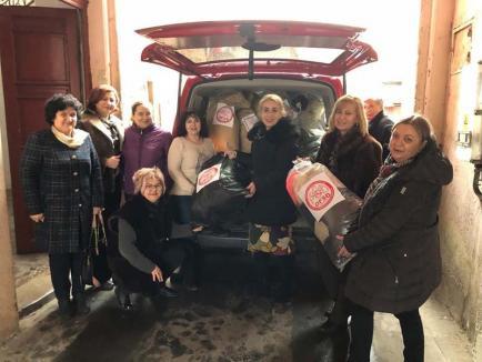 Cu sigla la Psihiatrie: Tovarăşele de la PSD Bihor au dus 50 de saci 'brenduiţi' cu haine bolnavilor de la Nucet