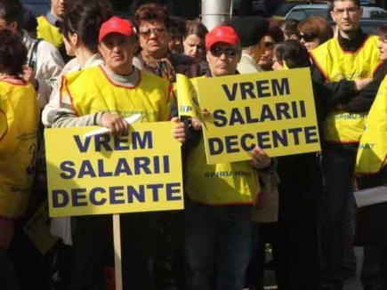 Austeritatea continuă: sistarea primelor şi reducerile de personal se vor face până în 2014
