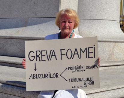 Greva foamei: Orădeanca Doina Pământ protestează împotriva abuzurilor celor care au construit un bloc distrugându-i proprietatea (FOTO)
