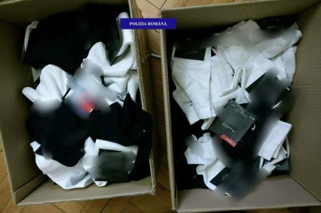 Percheziţii ale poliţiştilor antifraudă: Peste 400 de haine şi încălţăminte contrafăcute, ridicate din casa unui tânăr orădean (FOTO)