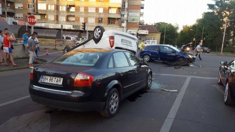 Accident cu 3 mașini pe Magheru: Un Opel izbit de un altul s-a răsturnat peste un Audi! (FOTO / VIDEO)