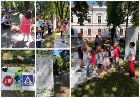 Educaţie rutieră, într-un parc din Oradea: Poliţiştii rutieri și cei de prevenire din Bihor, asaltaţi de copii (FOTO)