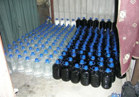 Au căutat droguri, dar au găsit un depozit clandestin de alcool etilic. Peste 3.500 litri de băuturi spirtoase au fost ridicate de la un orădean