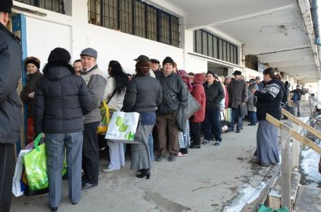 ASCO împarte porţii suplimentare de alimente pentru a compensa lipsa făinei şi uleiului (FOTO)