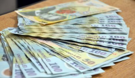 Guvernul a decis: Salariul minim creşte la 1.900 de lei din 1 ianuarie