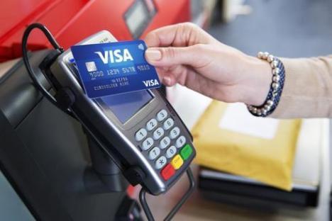Haos la plata cu cardul: Sistemul Visa, nefuncţional în Europa
