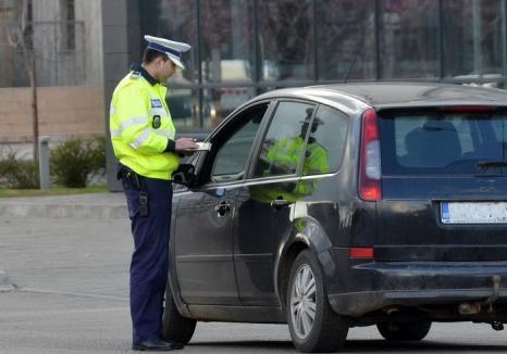Orădean de 24 de ani, prins cu un Audi cu numere şi acte false. Poliţiştii i-au făcut dosar penal și l-au lăsat fără maşină