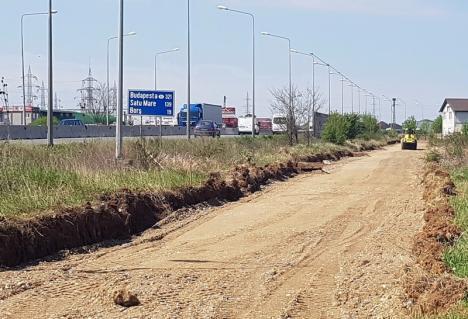 Lucrările la primul tronson de drum colector al şoselei de centură au început din Nufărul