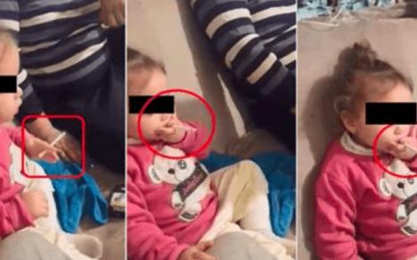 VIDEO ŞOCANT: O fetiţă de 2 ani, pusă de familie să fumeze şi să bea, spre amuzamentul adulţilor!