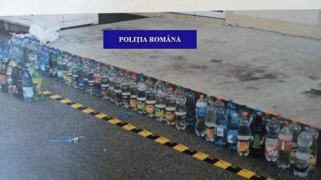 Controale ale Poliţiei Bihor: patroni cu dosare penale, peste 200 litri de alcool şi haine contrafăcute confiscate (FOTO)