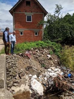 Prefectura cere Guvernului 13,3 milioane lei pentru pagubele inundaţiilor din Bihor(FOTO)