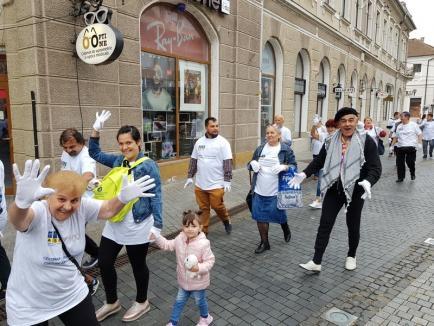 Marș cu mănuși albe, joi, în Oradea, pentru a marca centenarul Asociației Naționale a Surzilor
