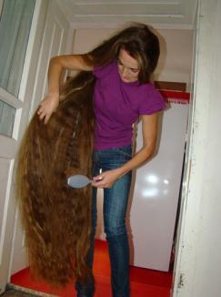 Părul unei românce este lung de 1,65 cm!