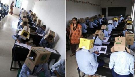 Scandal la o școală din India: elevii au fost puși să poarte cutii pe cap la examen