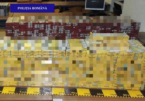 Captură de ţigări de contrabandă în centrul Oradiei: Un individ transporta 3.000 de pachete în maşină (FOTO)