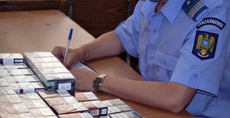 Jandarmii au descins în pieţele din Oradea: Au confiscat peste 3.900 de ţigări de contrabandă