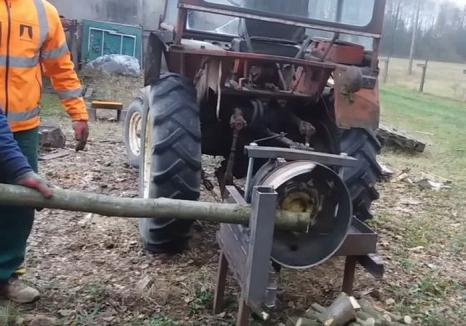 Accident teribil la Izbuc: Un bărbat de 40 de ani a fost prins de un aparat de tăiat lemne