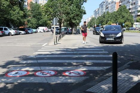 Nu mai folosi telefonul și căștile pe zebră! Marcaje speciale, desenate pe câteva treceri de pietoni din Oradea (FOTO)