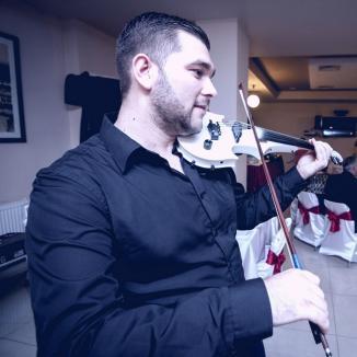 Despacito la higheghe! Un orădean cântă la vioară cu goarnă celebra melodie (VIDEO)