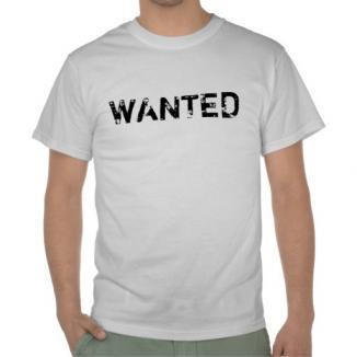 """Căutat de poliţie, a fost prins pentru că purta un tricou pe care scria """"Wanted"""""""