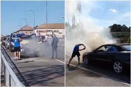 O maşină a luat foc pe Podul Carol I din Oradea. Un pompier aflat în timpul liber şi alţi orădeni au sărit să ajute (VIDEO)